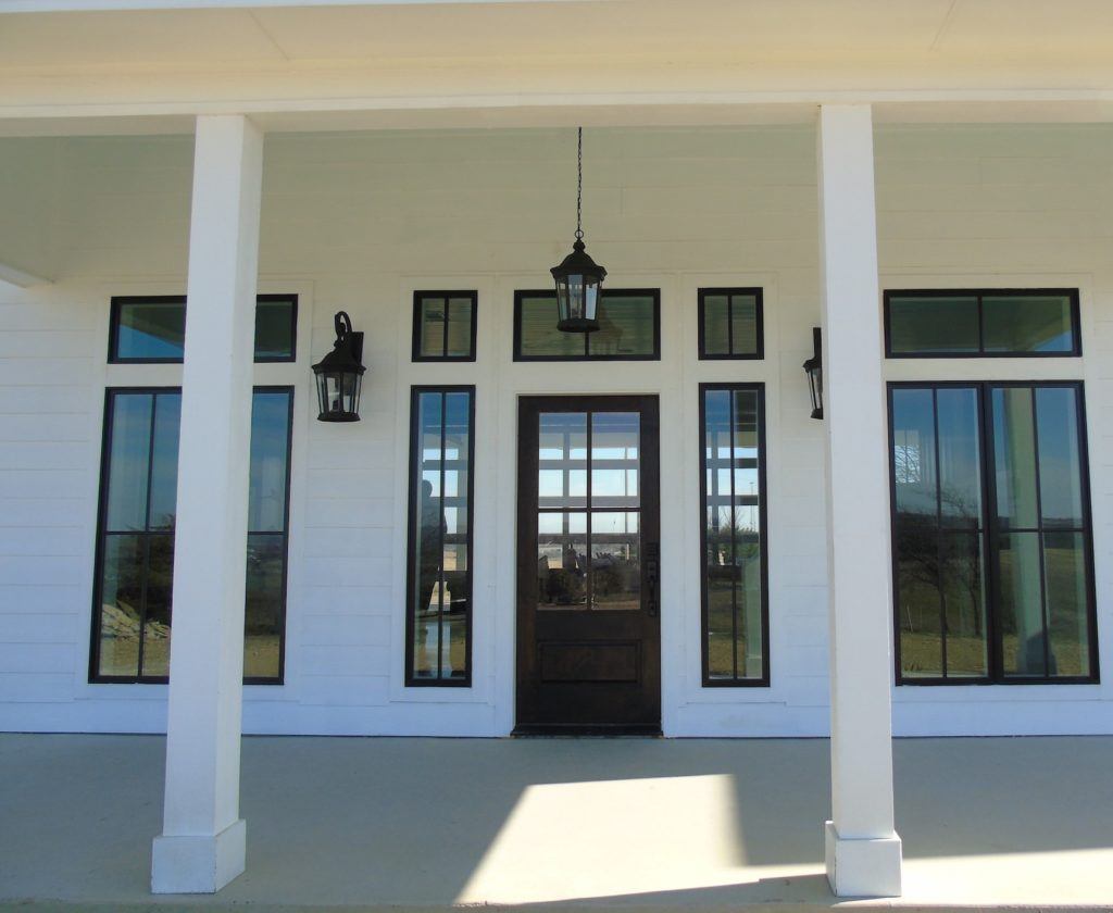 A modern yet classical design of the front entry of our newest and most popular home plans.